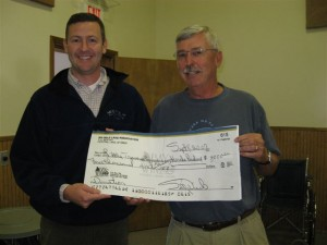 Six Mile Lake Association Presents The First Moneys To The Little Traverse Conservancy